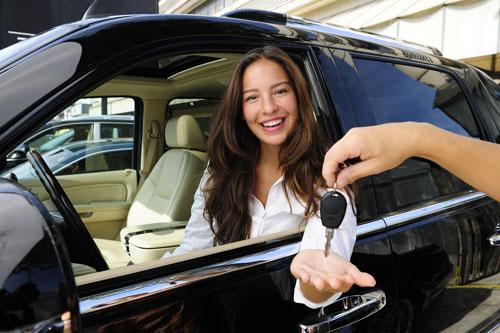 Women in rental car