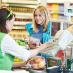 Customer with cashier in retail store