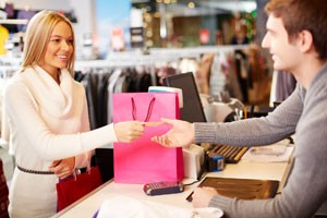 Shopper paying for clothes