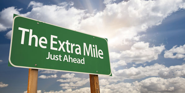 Going the extra mile signpost