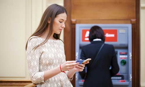 Women using a banking app on her mobile phone