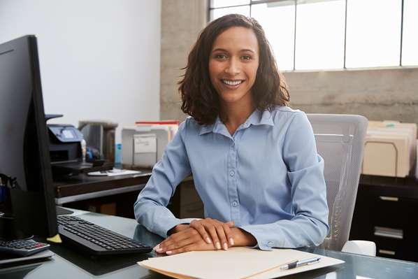 Happy staff member in her office