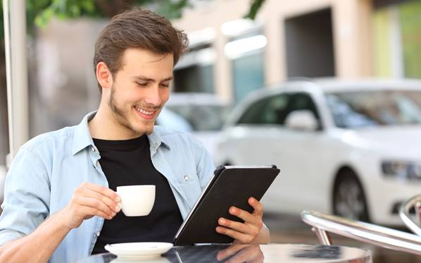 Man reading emails on tablet