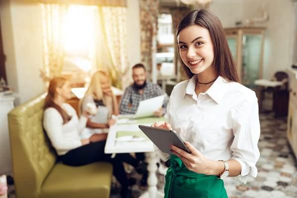 Waitress taking order on tablet