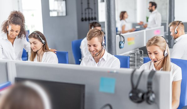 Call center agents working in an outsourced service center