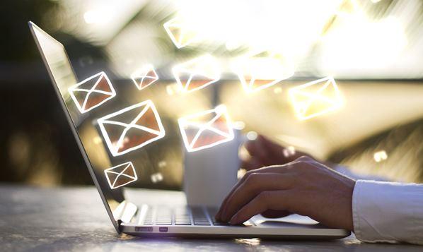 Man sending an email