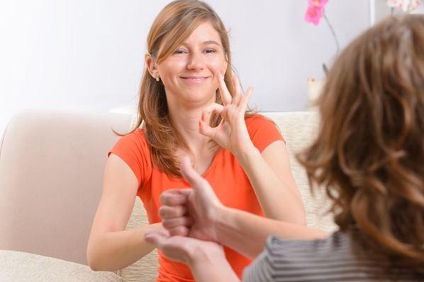 Women using sign language
