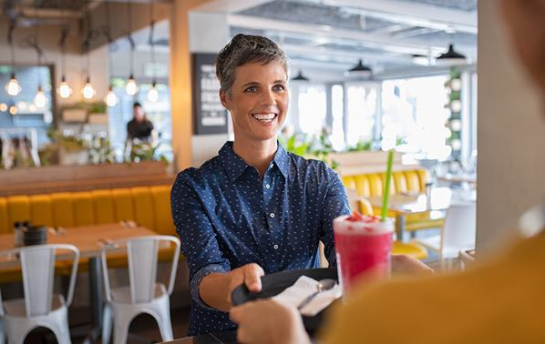 Waitress serving customer with a smile