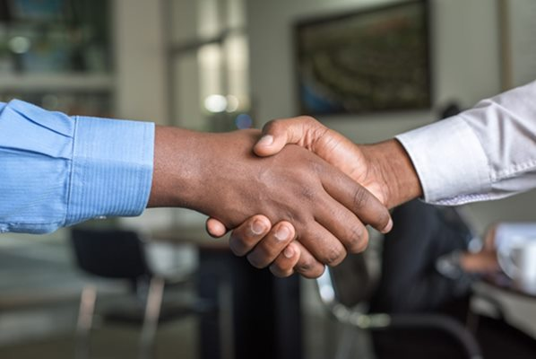 Job candidate shaking hands with recruiter