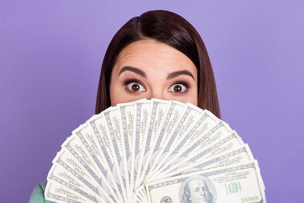 Women with a fan of money