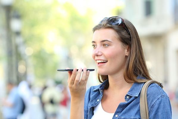 Girl using voice recognition on phone