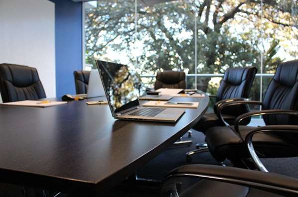 Meeting room with laptop on table
