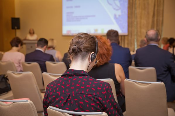 Delegate receiving translation by headphones at conference