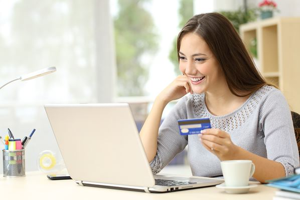 Customer speaking her credit card details when online shopping