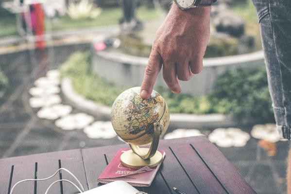Finger on globe