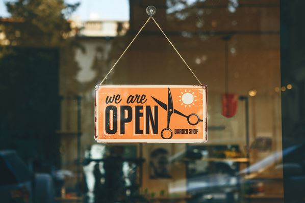 Open sign in hair salon doorway