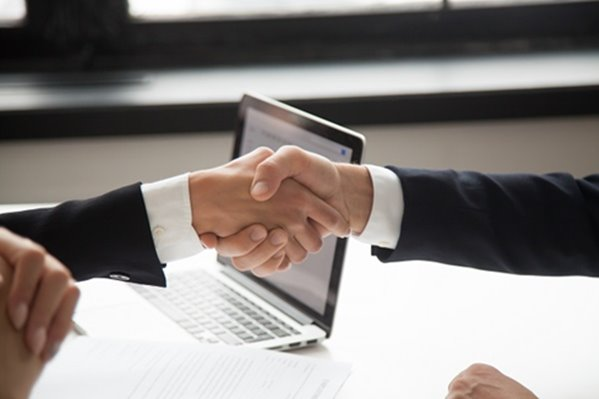 Lender shaking hands with client