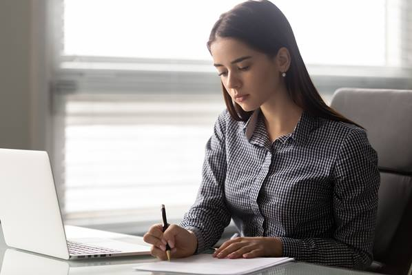 Manager writing correspondence