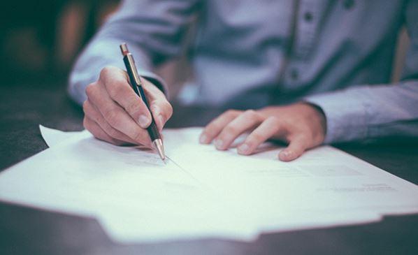 Manager writing marketing plan