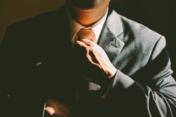 Businessman straitening on his tie