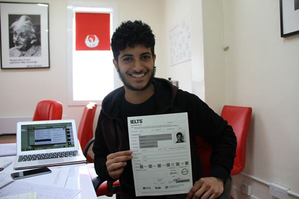 Student holding IELTS Exam certificate