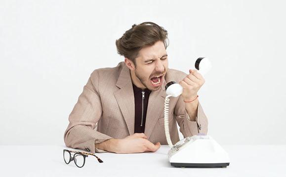 Angry customer shouting on phone