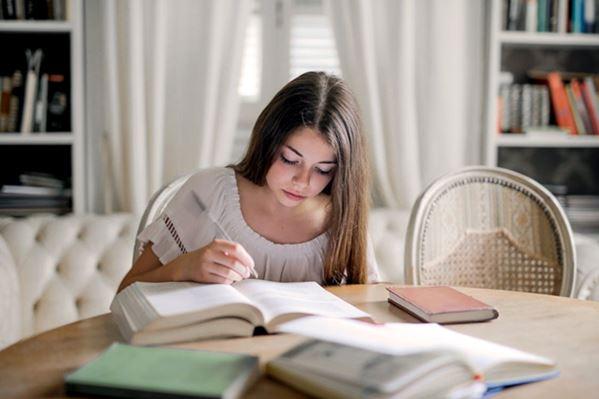 Student writing her CV