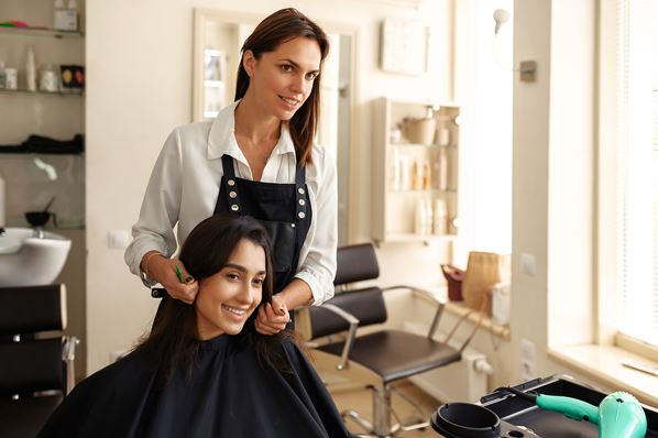 Hairdresser with client