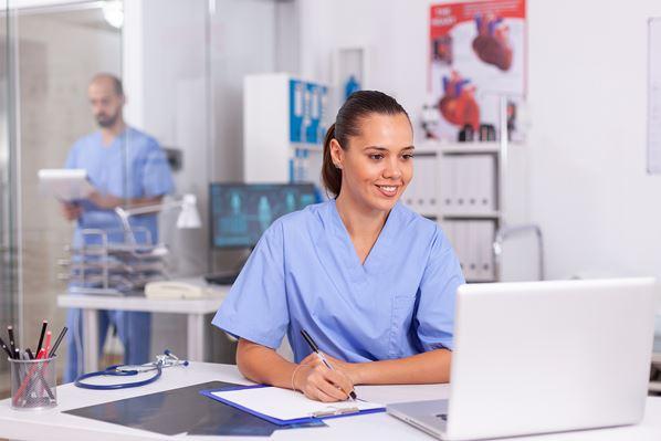 Nurse using patient portal software