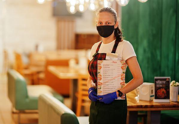 Waiter wearing mask in restaurant