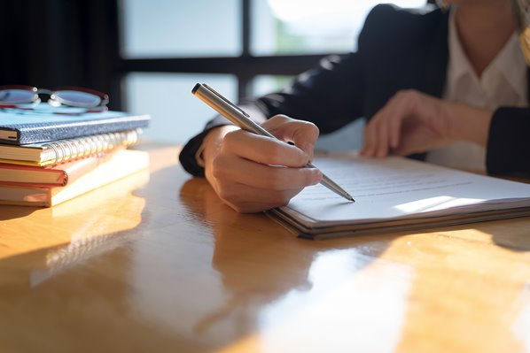 manager writing an employment contract