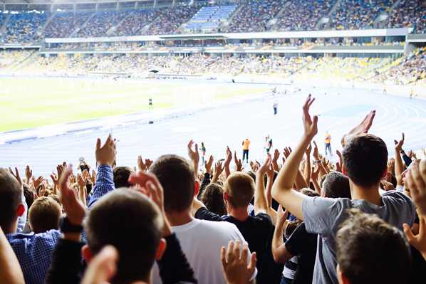 Australian NRL fans clapping in stadium
