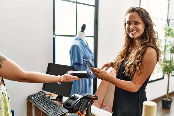 Customer paying with mobile phone in store