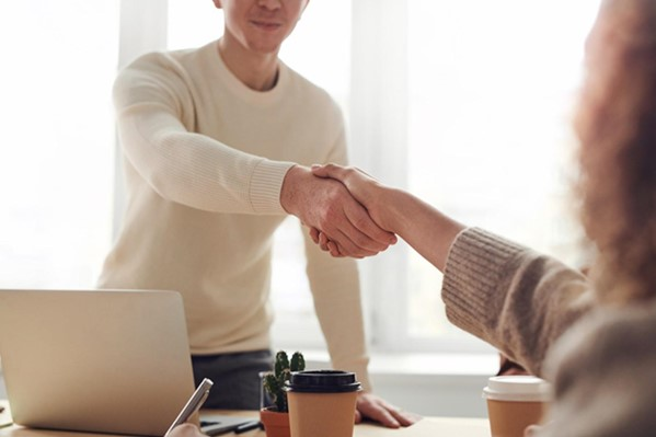 Candidate shaking hands with interviewer